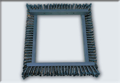 Linear brushes twisted knots mounted in a frame to be used used in the shakeout to clean the Moulding Boxes
